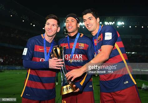 Lionel Messi, Neymar and Luis Suarez of Barcelona hold the ...