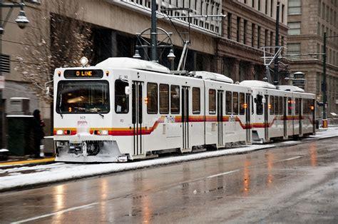 rtd light rail file denver lrvs in snow on stout st in downtown jpg