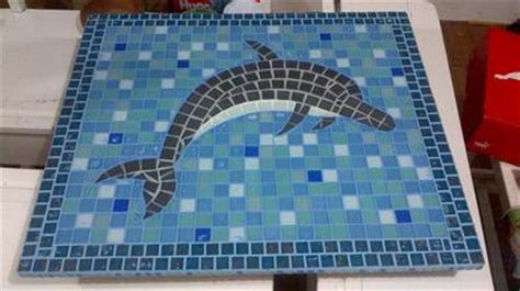 table top with a mosaic dolphin design