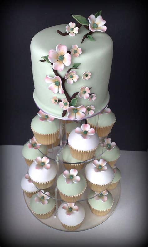 small  iced dogwood wedding cupcakes cutting cake