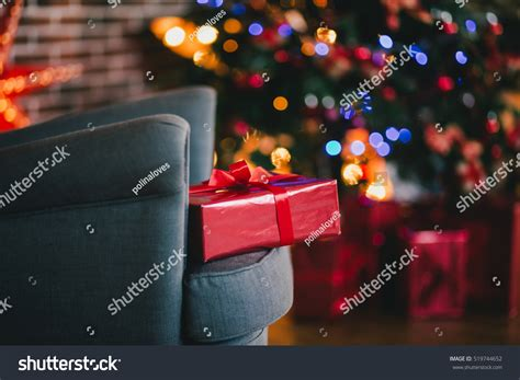 under the christmas lights presents the tree lights background stock photo 519744652