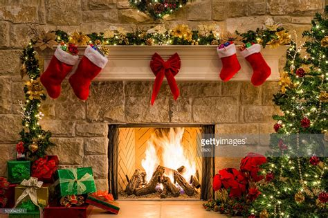 christmas fireplace tree stockings fire hearth lights and decorations stock photo getty images