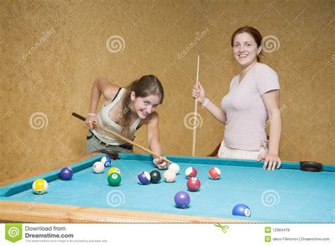 women playing billiards royalty  stock  image