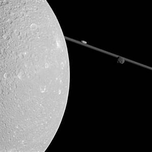 APOD: 2012 May 21 - A Close Pass of Saturn's Moon Dione