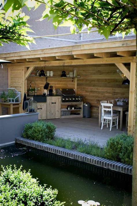 photo cuisine exterieure jardin barbecue fixe fonctionnel et esthétique dans le jardin