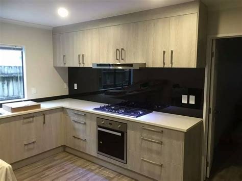 pictures of kitchens with white cabinets and black countertops new house kitchen icon kitchens auckland 9945