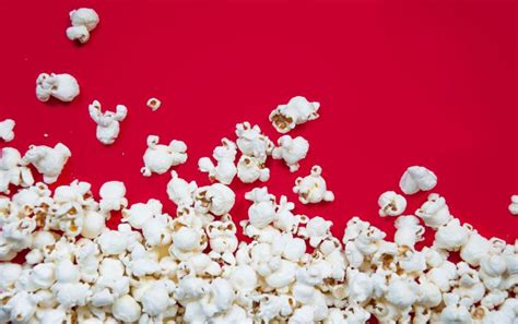 popcorn background popcorn spilled on background free stock photo by