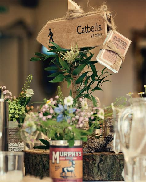 Hiking themed table centres with rustic flowers Gorgeous