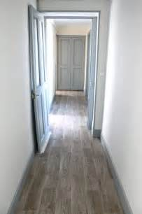 these greyish brown floors plus light blue gray doors trim with white or light gray
