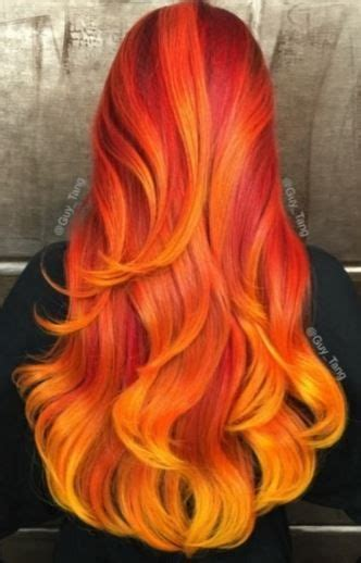 wavy red orange yellow ombre hairstyle dyedhair