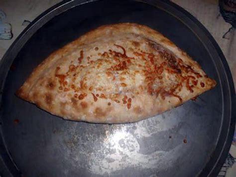 recette de pizza calzone classique mozzarella jambon oeuf