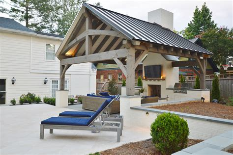 lovely outdoor kitchen  poolside living area
