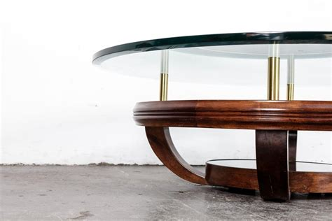 Complement your living room with this set of two round nesting tables with 16mm particle board or 8mm tempered glass tops and sturdy sleek metal bases. Unique Brazilian Bi-Level Glass Top Round Coffee Table with Wood Base For Sale at 1stdibs