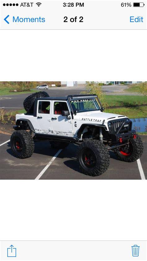 4 door jeep wrangler jacked up jacked up jeep wrangler jk white lifted light bar flat top