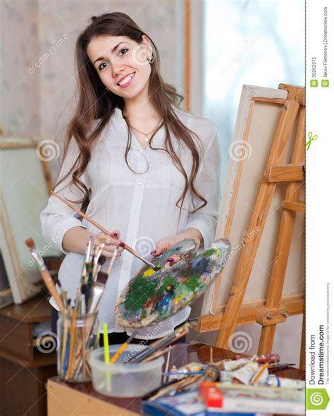 Happy Girl Paints On Canvas With Oil Colors Royalty Free