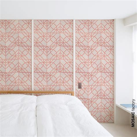 feature bedroom wall with decorative pink patterned tiles