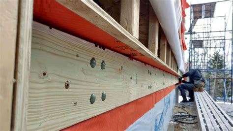 attaching  deck   superinsulated fat wall