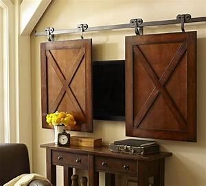 hidden treasures how to hide your tv With barn doors to hide tv