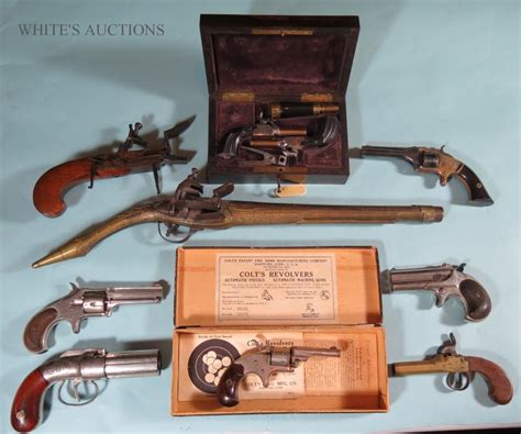 whites auctions february   fine art silver antique guns dolls history