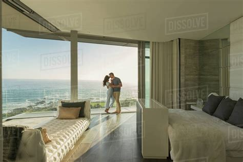 affectionate couple hugging  modern luxury home showcase