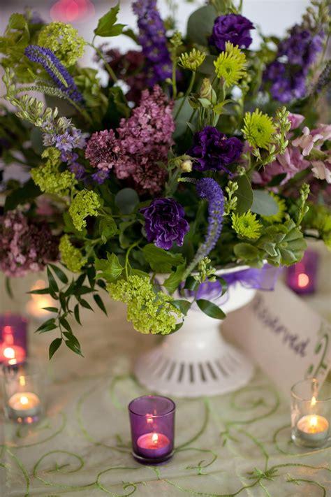 pedestal purple  green flower arrangement