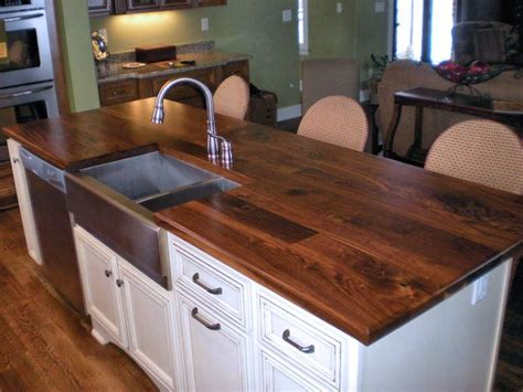 white kitchen island with butcher block top sink cutouts in custom wood countertops