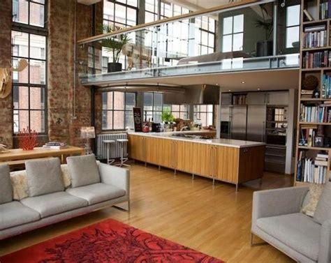 photo  split level warehouse living grey exposed brick apartment living room mezzanine studio