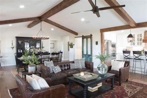 open concept living space  exposed beam vaulted ceilings hgtv