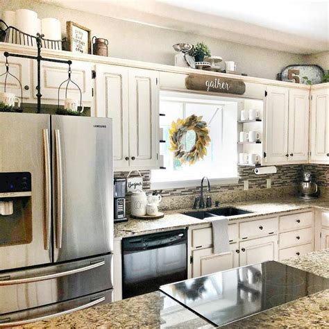 how to decorate the top of your kitchen cabinets 10 ways to decorate above your kitchen cabinets