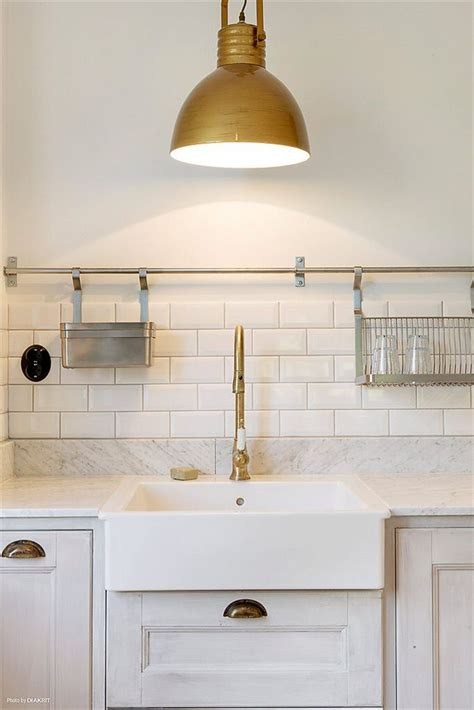 solid brass kitchen faucet mixed metals in the kitchen glitter and goat cheese