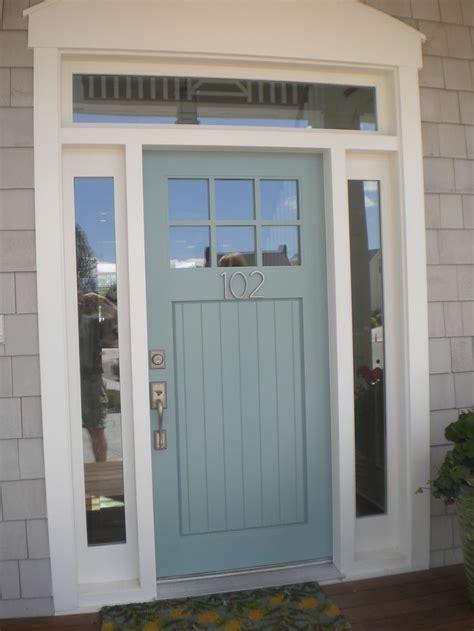 blue fiberglass modern   glass panel  white wooden frame  door  exterior