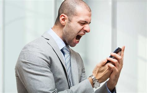 Portrait of an angry businessman yelling at phone - GO-SEO