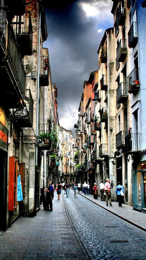 narrow street  girona spain android wallpaper