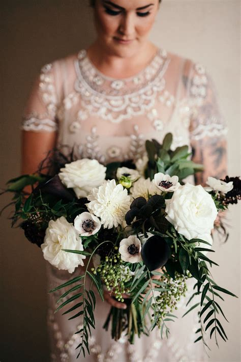 flowers  lace  lilies dark  moody bridal bouquet