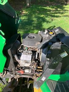 John Deere X585 Riding Mower With Attachments