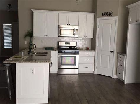 White shaker cabinets, white subway tile backsplash
