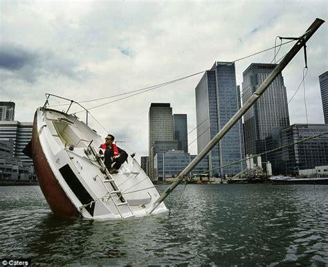 Sinking Boat by Designer Julien Berthier Travels The Globe In