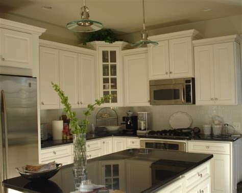 8 best images about staggered kitchen cabinets on