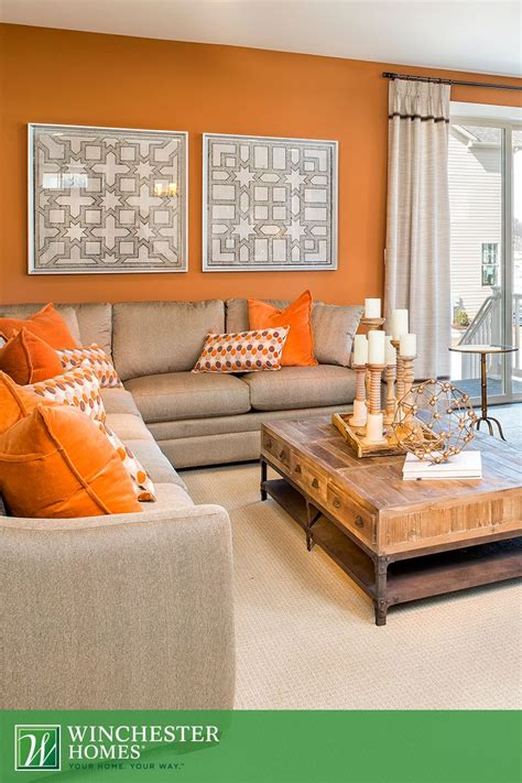 Living Room Decor With Orange Walls by Orange Walls Patterned Artwork And Light Carpets Add To