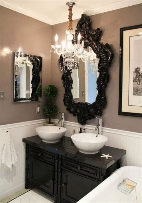 Oversized Black Framed Mirror Takes Up Height Of Wall From