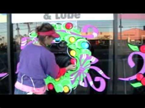 holiday christmas window painting wreath artist kim cooper