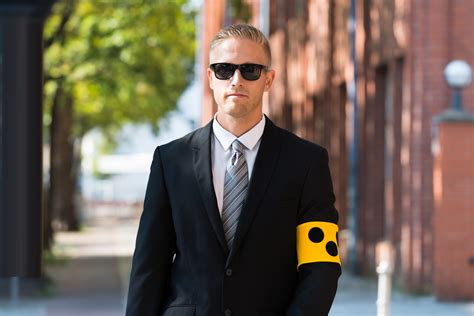 blind person wearing armband  sight matters