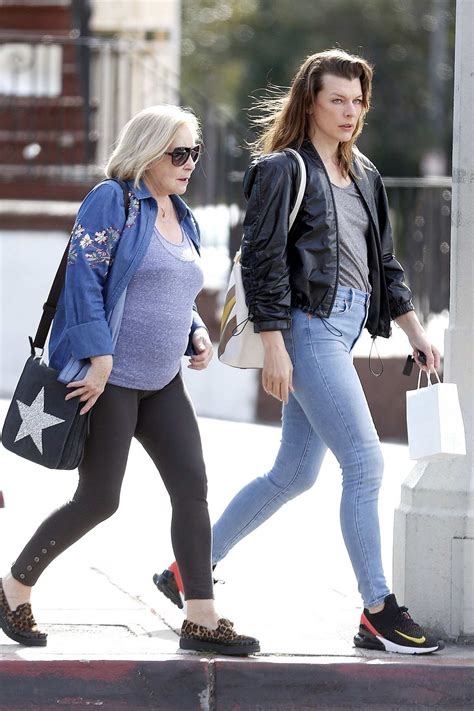 milla jovovich steps   jeans  leather jacket   shopping trip   mom  west