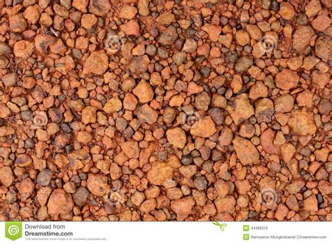ghiaia rossa laterite gravel for background stock photo image