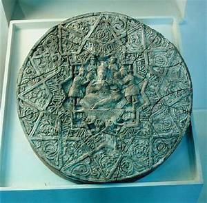 Sun disc depicting a king sitting cross- - Islamic School