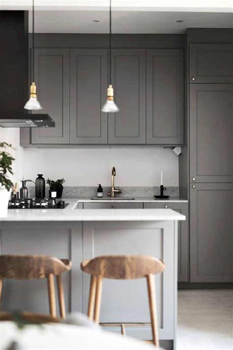dark grey kitchen  marble worktop  brass details
