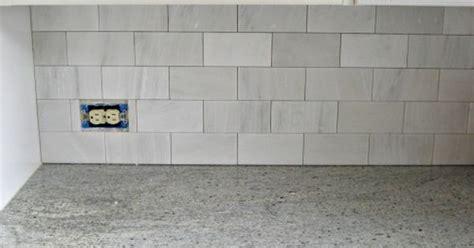 The tiles are the Hampton Carrara 3×6 subway tile in satin