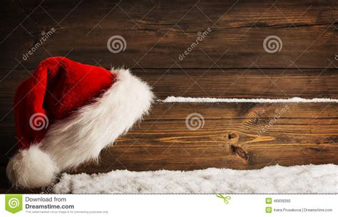 christmas santa claus hat hanging  wood plank xmas