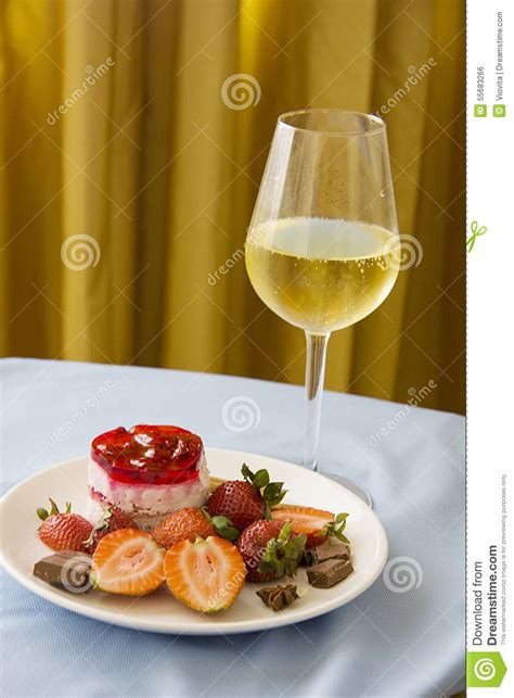 Glass Of Champagne With Strawberries On Golden Background