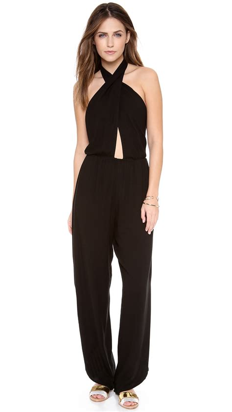 halter jumpsuits indah pearl cross front halter jumpsuit in black lyst